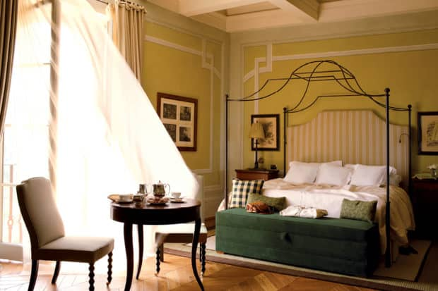 A romantic bedroom catches a breeze at Rosewood Castiglion del Bosco in Tuscany, Italy.