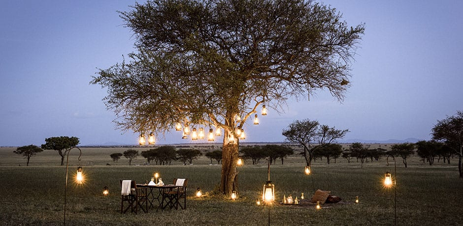 Dinner under an acacia tree at Singita Sabora, Tanzania