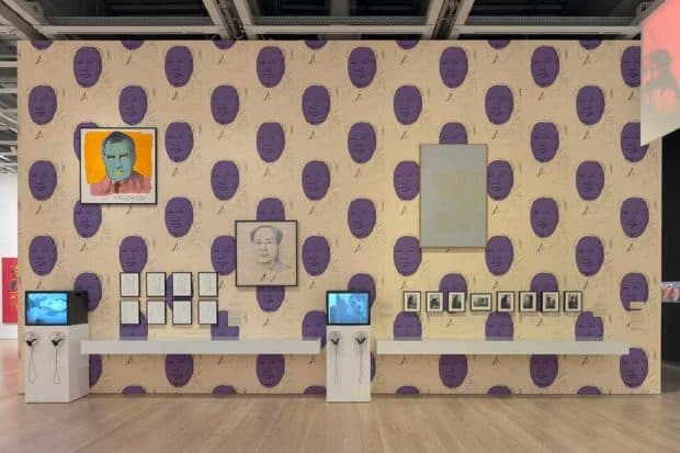 Installation view of Andy Warhol – From A to B and Back Again (Whitney Museum of American Art, New York, November 12, 2018-March 31, 2019). From left to right: Factory Diary: Andy Paints Mao, 1972; Vote McGovern, 1972; Mao (Edition 4/300), 1973; Mao (Edition 27/300), 1973; Mao (Edition 32/300), 1973; Mao (Edition 39/300), 1973; Mao (Edition 103/300), 1973; Mao (Edition 204/300), 1973; Mao (Edition 242/300), 1973; Mao (Edition 261/300), 1973; Mao, 1973; Factory Diary: Andy Warhol, Geri Miller, Candy Darling at the Factory, c. 1971-72; Michael Kostiuk, Andy Warhol vacuuming the carpet for an installation piece at Finch College Museum of Art, c. 1972; White Painting [Torso], 1966; Ronald Nameth, Andy Warhol's Exploding Plastic Inevitable, 1966. Photograph by Ron Amstutz. © 2018 The Andy Warhol Foundation for the Visual Arts, Inc. / Licensed by Artists Rights Society (ARS), New York.