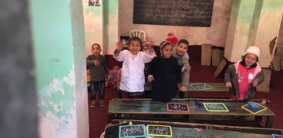 Enthusiastic greeting from children at the koranic school