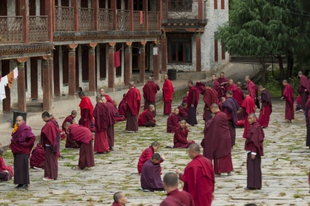 Monks in the courtyard at Karchung Goemba, Bhutan (courtesy COMO Uma Paro)