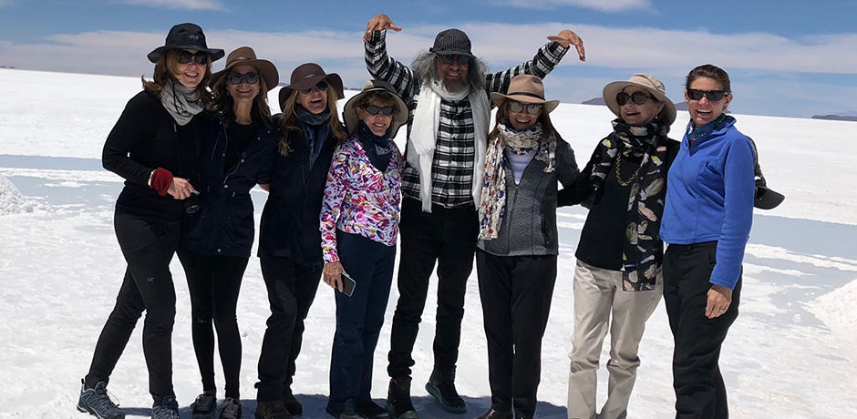 Members of the Indagare Journey pose with Gaston Ugalde, Bolivia's most famous artist (center), who accompanied the group throughout the trip.