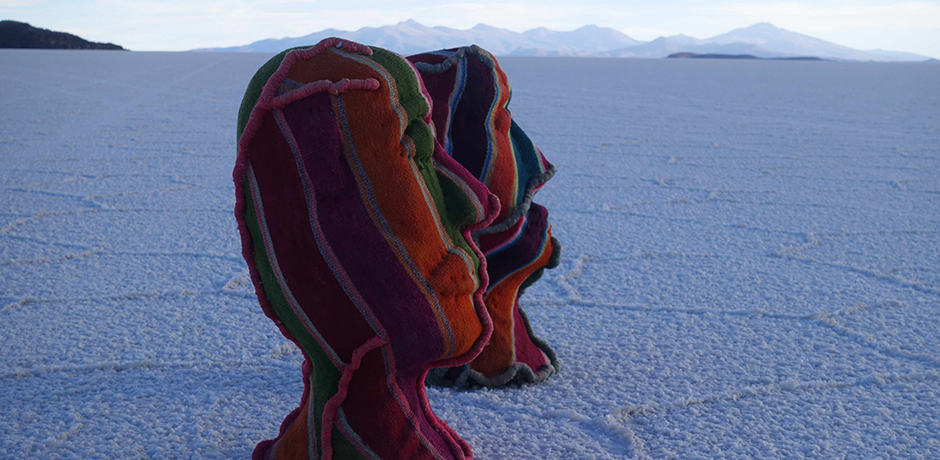 Ugalde's sculptures made with traditional Bolivian weavings are a beautiful contrast to the endless white scenery.