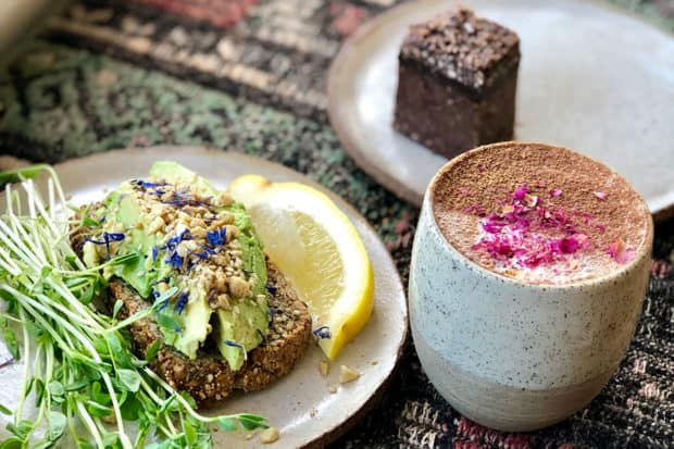 Avocado toast, a latte and a raw chocolate tart at Orchard St.