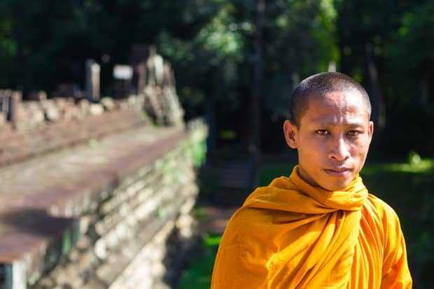 A monk in yellow garb in Cambodia