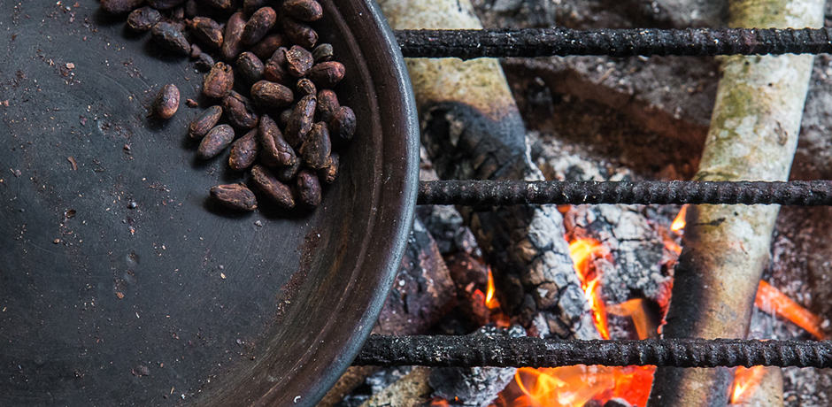Cocoa beans are roasted over a fire. Cocoa is one of the chief exports of Ecuador and has been graded by regulatory agents in the industry as the best chocolate in the world.