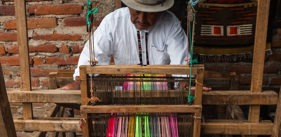 Luis is an artisan weaver who no longer takes his wares to market, as his designs are often imitated, at lower quality, by competitors. It takes about an hour for him to make a blanket on his family's 200-year-old loom.