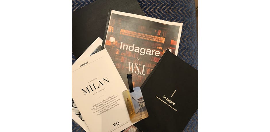 The Indagare x WSJ. Magazine departure package our group received prior to heading to Milan, including a reading list with selected articles, a personalized luggage tag and more.