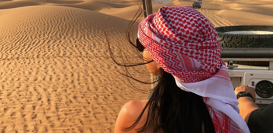 Indagare Marketing Director Diana Li traversing the desert in Dubai.