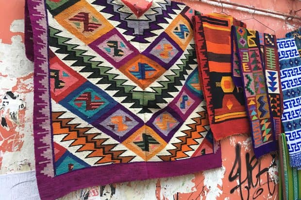 4 colorful weavings hanging on a wall in La Paz Bolivia