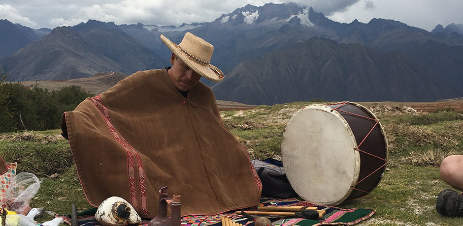 Juan, a local Shaman, makes a spiritual offering to Patchamama (Mother Earth)