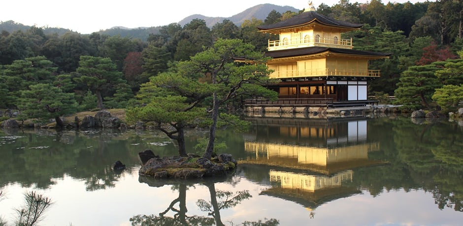 Buddhist temple Kinkaku-ji (Temple of the Golden Pavilion) in Kyoto is covered with pure gold leaf, a radiant sight at sunset