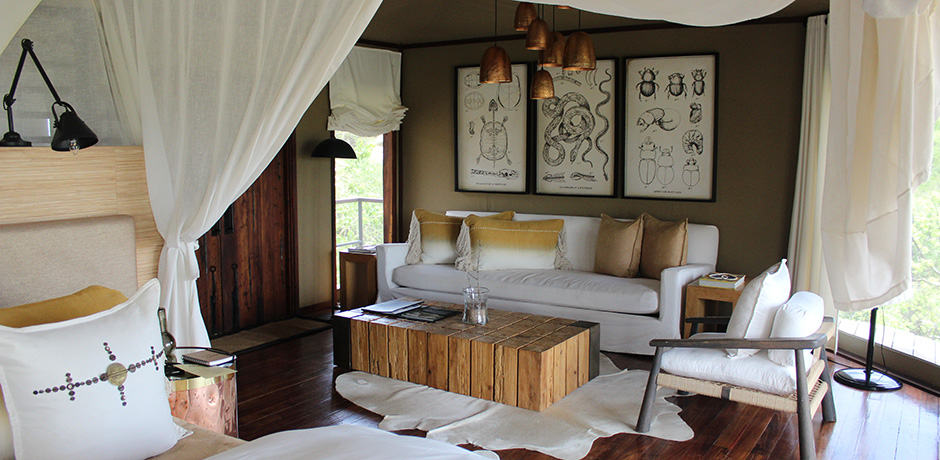 Luxury safari-style décor in a bedroom seating area at Mwiba Lodge
