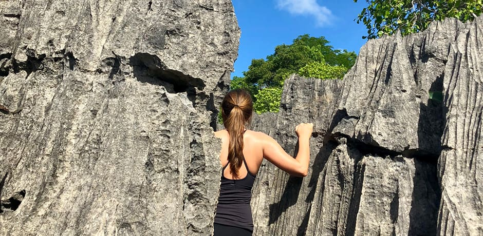 Destinations Editor Emma Pierce exploring tsingy while scouting in Madagascar.