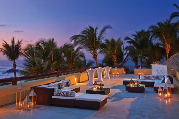 Outdoor lounge at sunset at Four Seasons Punta Mita in Mexico