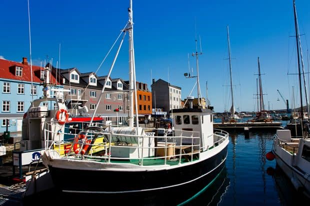 Boats moored in the harbour which is located next to the historical area known as Tinganes, in the city of Torshavn.