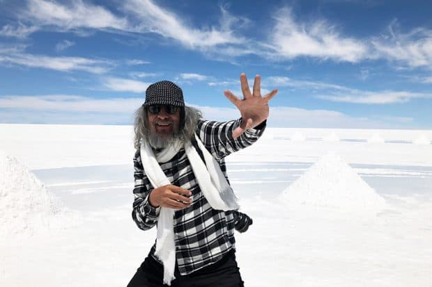 Gaston Ugalde poses for a photo while exploring the salt flats