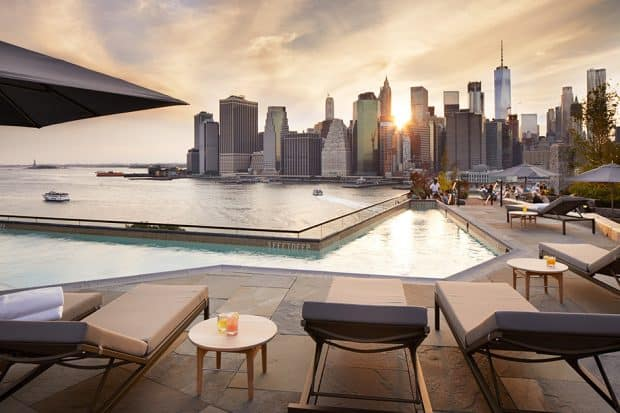 Rooftop pool and lounge chairs at 1 Hotel Brooklyn Bridge