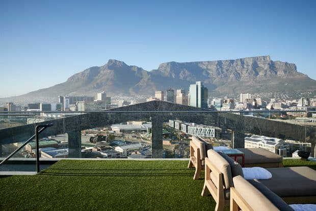 Grass-covered roof deck with lounge chairs at The Silo, Cape Town, South Africa