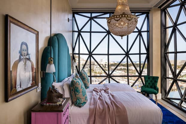 Bed under chandelier at The Silo, Cape Town