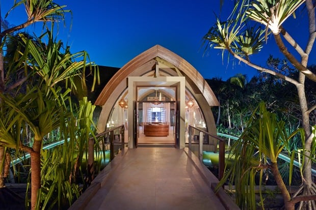 Entrance at dusk of The Brando, French Polynesia, South Pacific; Courtesy Tim McKenna