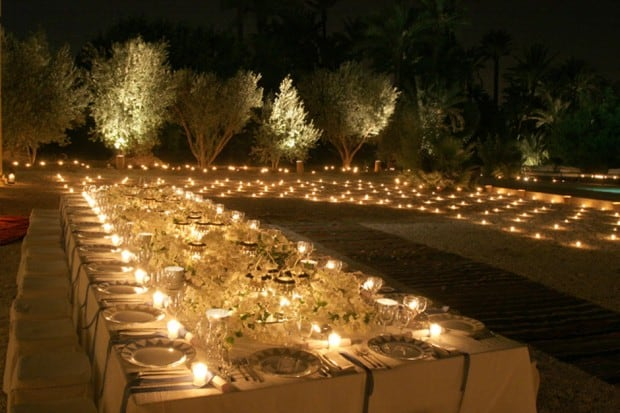 Long candlelit outdoor dining table at Jnane Tamsna hotel in Marrakech