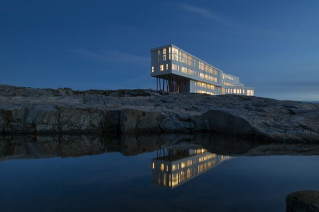 Exterior of Fogo Island Inn in Newfoundland reflecting in lake