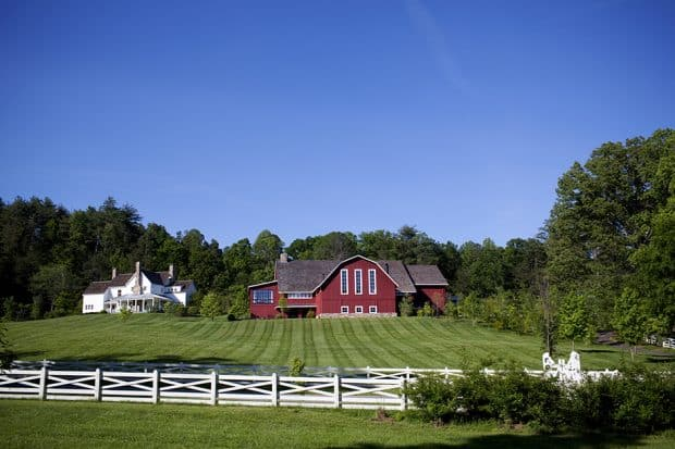 Red barn and white fence at Blackberry Farm in Tennessee