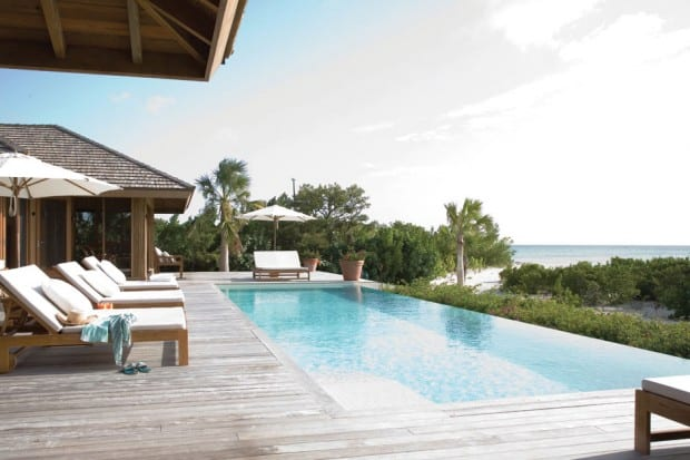 Wooden patio and pool at Parrot Cay