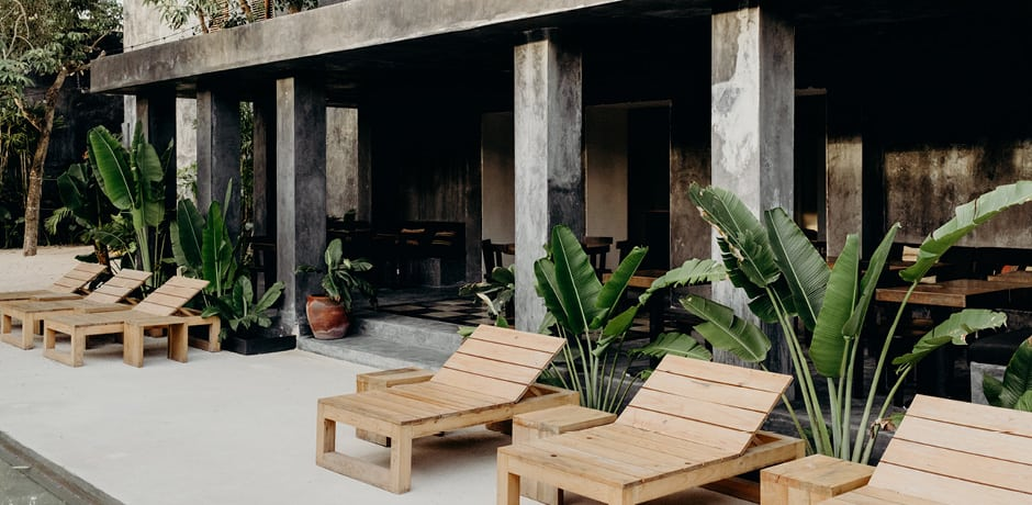 The pool deck and terraced restaurant at Casa Pueblo Tulum. Photo by Benjamin Holtrop.