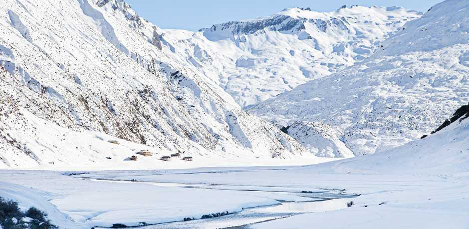 Snow blankets the glacial valley that is home to the Alpine Lodge at Minaret Station, New Zealand. Courtesy Minaret Station.