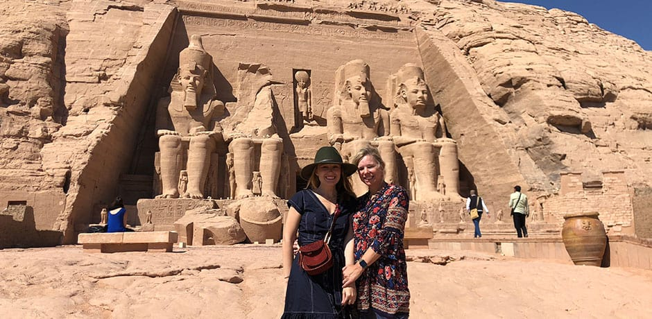 Avery Carmichael and her mom, Susan Reynolds Lehman, at Abu Simbel on Indagare's Egypt Insider Journey.
