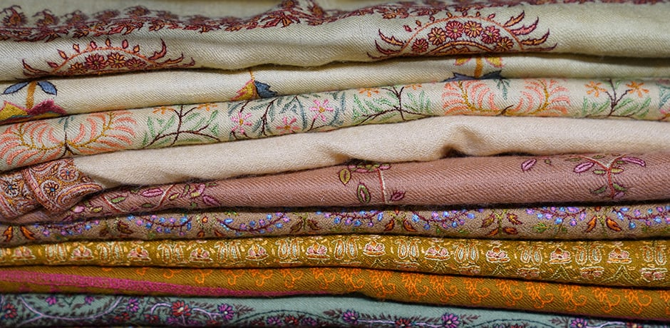 A stack of Indian embroidered pashminas, courtesy Charlotte Moss