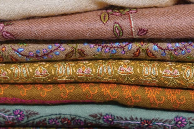 insider journeys india with lisa fine pile of fabrics