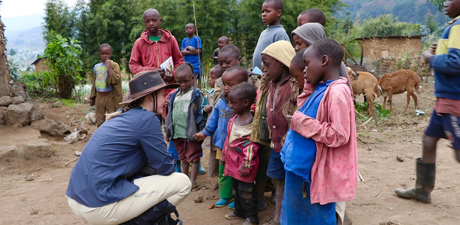 An Indagare member meets local children on the 2018 Insider Journey to Rwanda. Courtesy Simone Mailman