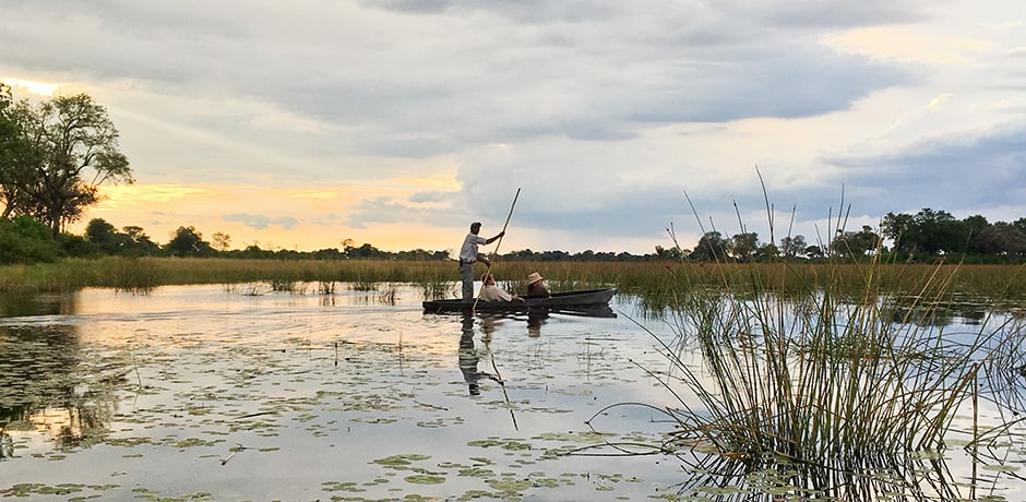 Exploring the Delta by Mokoro, a dug-out canoe