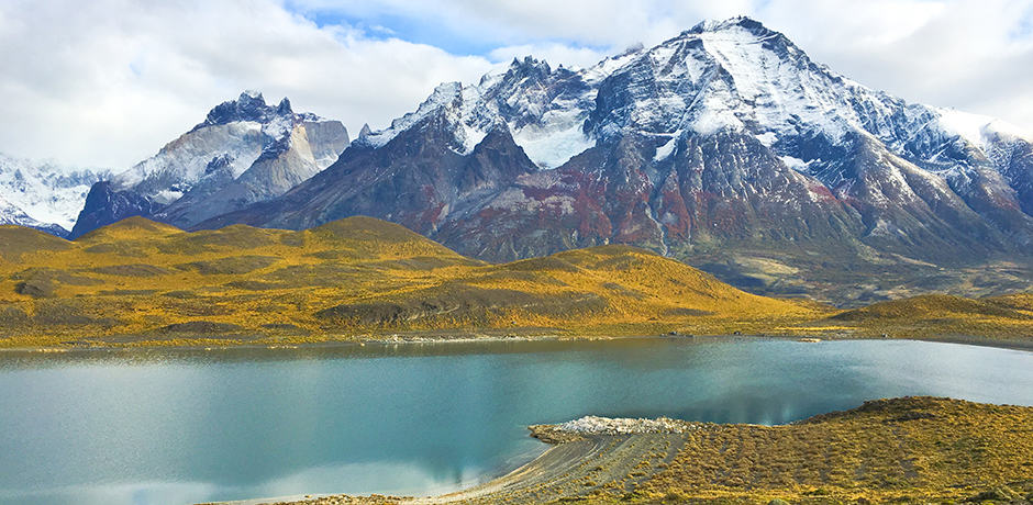 Snow-capped mountains and glacial lakes can be seen on a hike in Chilean Patagonia.