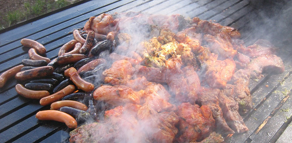 An array of meats—including pork, lamb, beef and alpaca—cooks over a eucalyptus-stoked grill.