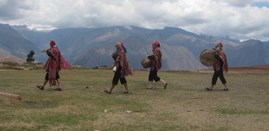 Music in the mountains: a band playing traditional instruments crosses a field high above the Urubamba Valley.