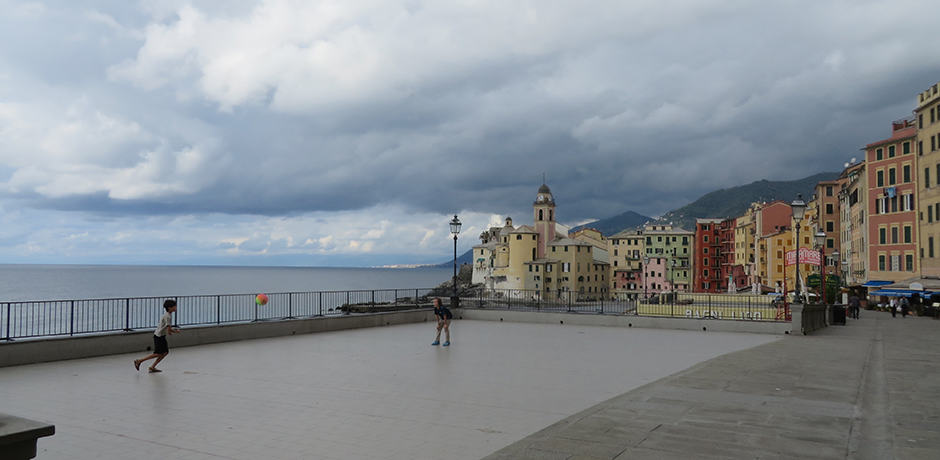 Local children playing soccer in the coastal town of Camogli