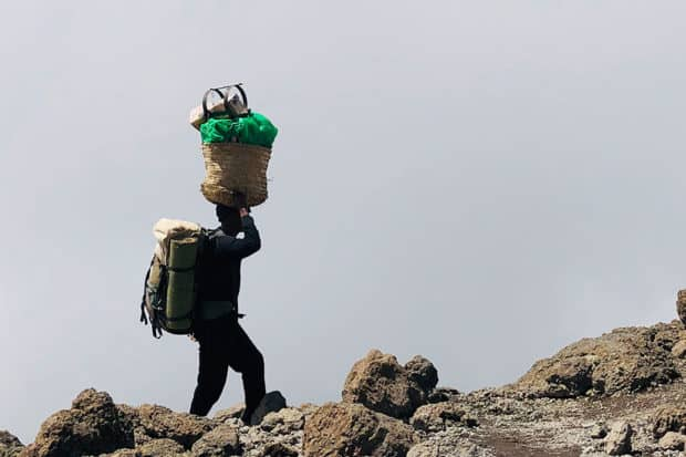 A porter on the way to Barafu Camp