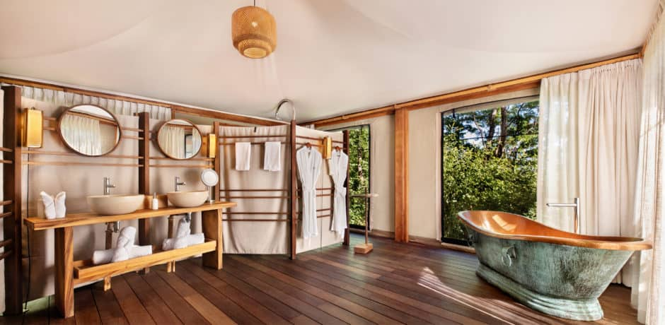 The bathroom of the Lazy Turtle 2 tented suite, which offers an indoor shower and bathtub, as well as an outdoor shower and private sun deck. Photo courtesy of Kasiiya Papagayo.