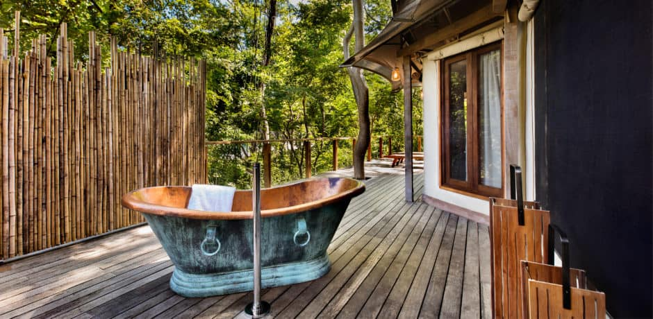 An al fresco bathtub on the private deck of the Lazy Turtle 3 tented suite. Photo courtesy of Kasiiya Papagayo.