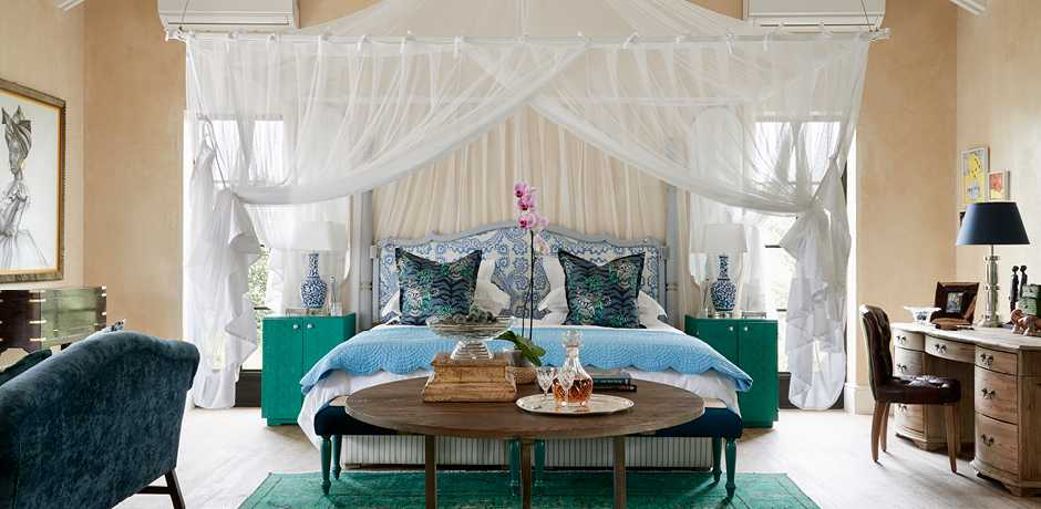 A bedroom in the luxury farm suite at The Farmstead at Royal Malewane, South Africa. Courtesy the Royal Portfolio.