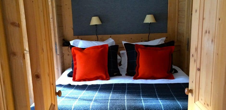 Cozy guest rooms at the new M hotel in Megève feature chic and sumptuous Arpin blankets and upholstery.