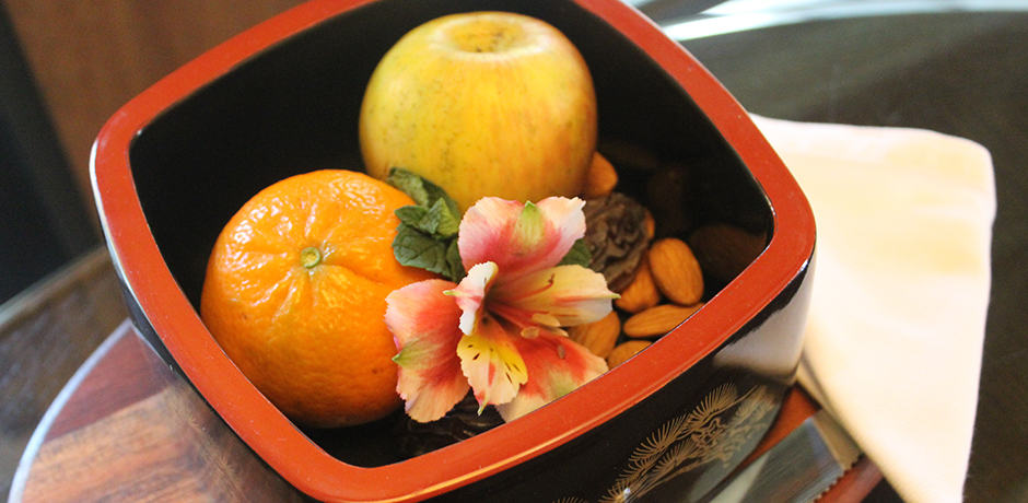 A healthy snack at the Golden Door might consist of an apple or orange and a handful of almonds.