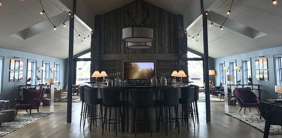 The main lounge area at Deplar boasts a full bar, seating area with a fireplace, lots of little nooks, pool and  foosball tables and a darts board.