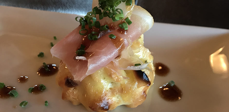 The Chef's Tasting Menu is served twice a week, year-round. This gastronomic meal started with a gougère with prosciutto.