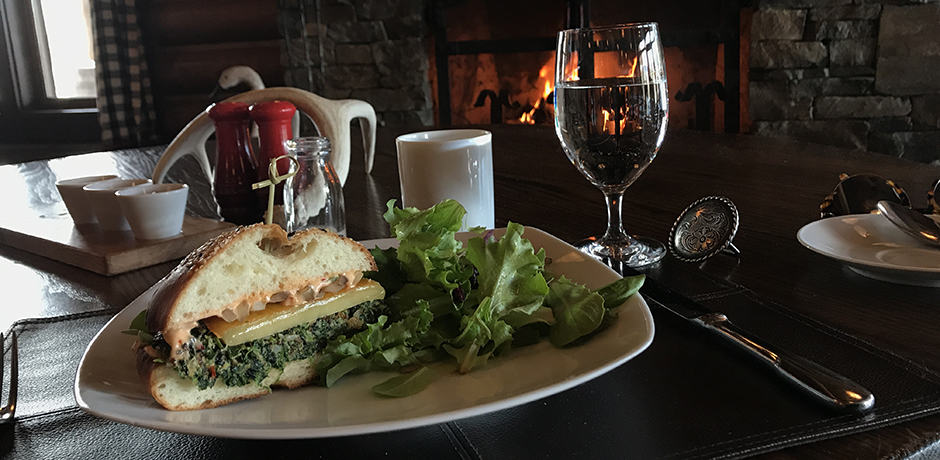 A fireside lunch in the Granite Lodge. The veggie burger, pictured here, is one of the most popular offerings (and a secret recipe!).