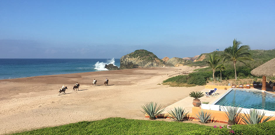 An early morning ride culminates at the beach in front of Casa La Playa.